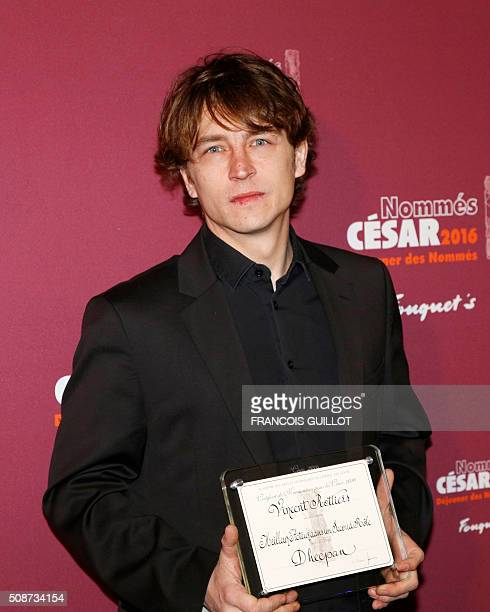 French Vincent Rottiers poses with his nomination certificate for Best Actor in a Supporting Role during the nominations event for the 2016 César...