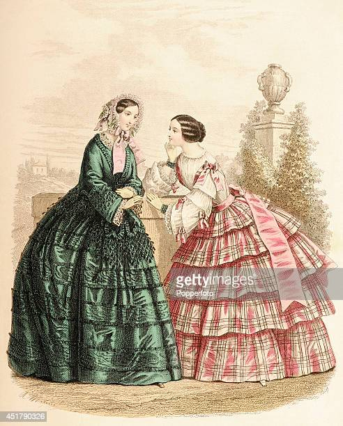 A French vintage fashion illustration featuring two stylish ladies in conversation in a parkland setting published in Paris circa August 1854