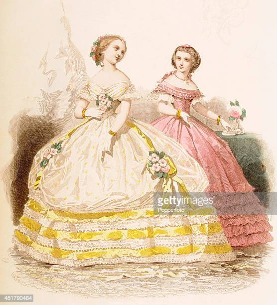 A French vintage fashion illustration featuring two sylish ladies wearing elaborate ballgowns published in Paris circa January 1860