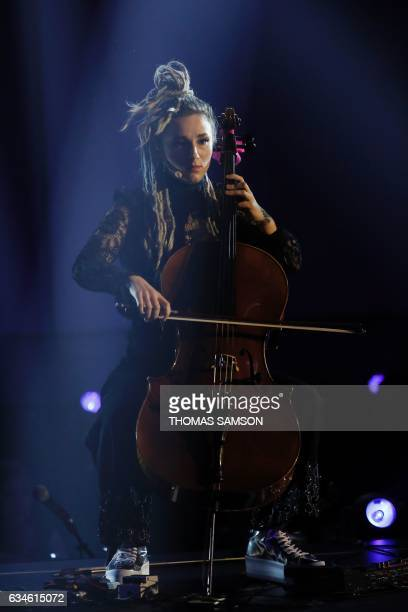 French violoncellist of the LEJ band Juliette Saumagne performs on stage with her band during the 32nd Victoires de la Musique the annual French...