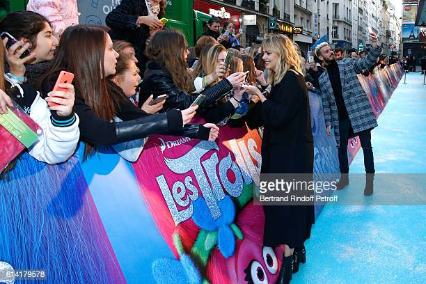 French voices of the movie Louane Emera and Matt Pokora signing autographs attend 'Les Trolls' Paris Premiere at Le Grand Rex on October 12 2016 in...