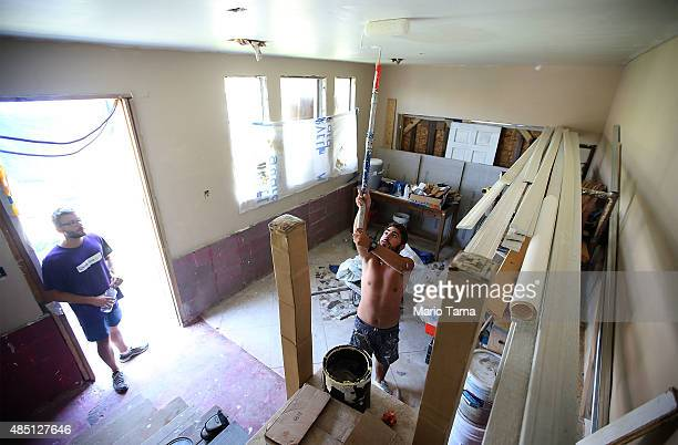 French volunteers from lowernineorg help rebuild a heavily damaged home in the Lower Ninth Ward on August 24 2015 in New Orleans Louisiana The area...