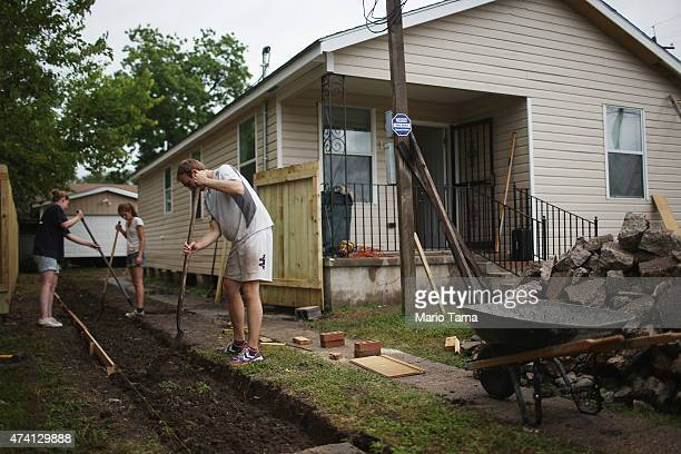French volunteers with lowernineorg help rebuild a home heavily damaged by Hurricane Katrina flooding in the Lower Ninth Ward on May 15 2015 in New...
