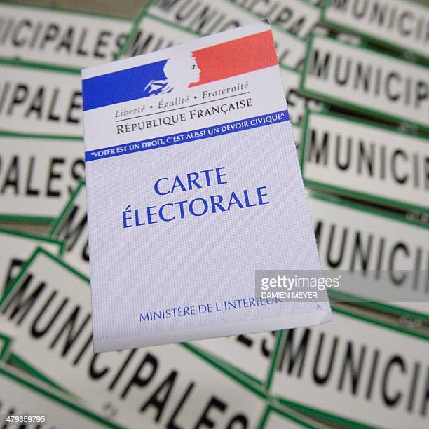 A French voting card is displayed on 'Mayoral' signs in a warehouse owned by the town hall of Rennes western France on March 18 2014 France holds...