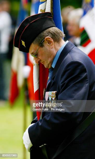 A French war veteran pays his respects during an international wreath laying ceremony at the Bayeux Military Cemetery in Normandy France ahead of...