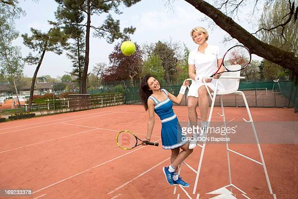 French weather presenters Nathalie Rihouet and Anais Baydemir pose at the sport center of the Bois de Boulogne on April 25 2013