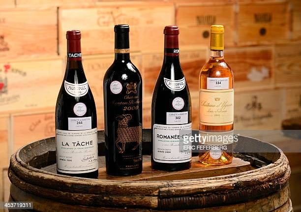 French wine bottles a La Tache a Chateau Mouton Rothschild 2000 a RomaneeConti 2004 and a Chateau Yquem Lur Saluces 1995 from the cellars of the...