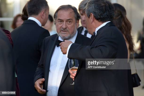 CORRECTION French winemaker Michel Rolland attends the 65th 'Fete de la Fleur' at Chateau MalarticLagraviere in Leognan southwestern France on June...