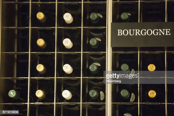 French wines sit on display at the Isetan Shinjuku department store operated by Isetan Mitsukoshi Holdings Ltd in Tokyo Japan on Tuesday July 11 2017...