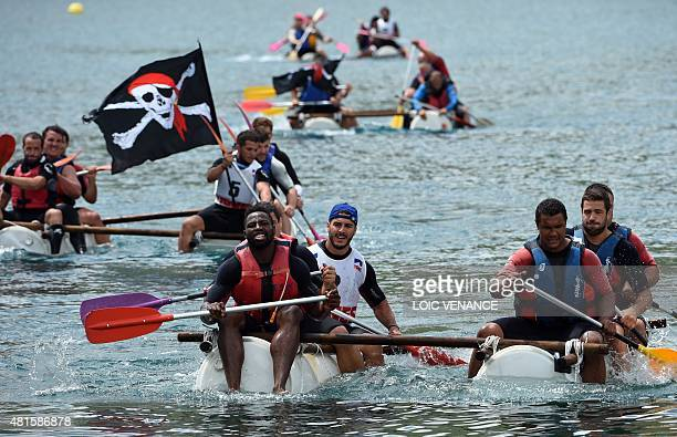 French wing flanker Fulgence Ouedraogo and French wing flanker Thierry Dusautoir and others take part in a raft contest as part of the French rugby...