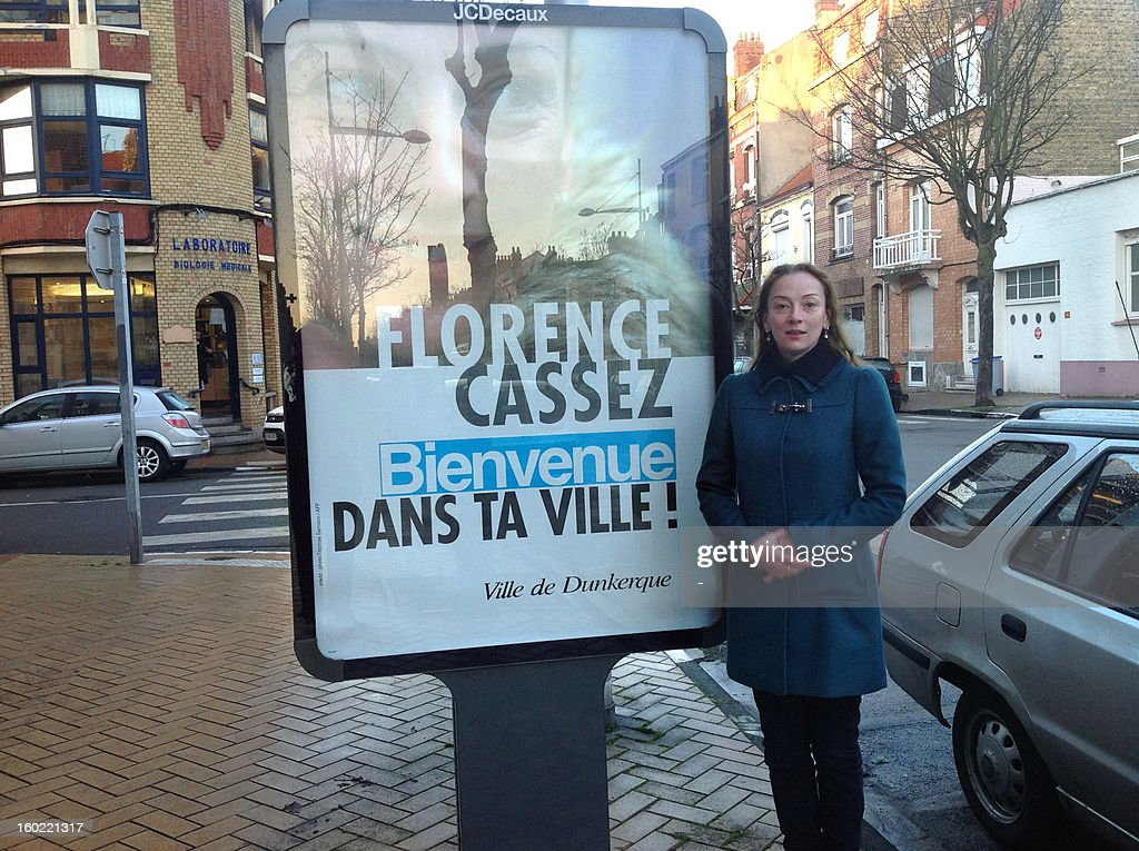 French woman Florence Cassez poses by a billboard reading in French 'Florence Cassez, welcome in your city,' on January 28, 2013 in Dunkirk, Northern France, few days after Mexico's Supreme Court ordered her released after seven years behind bars, citing violations of her civil rights. Cassez, who is now 37 and has spent more than six years in a Mexican jail, has denied any knowledge of the crimes and claims the authorities made an example of her when she was sentenced to 60 years in jail for kidnapping. AFP PHOTO