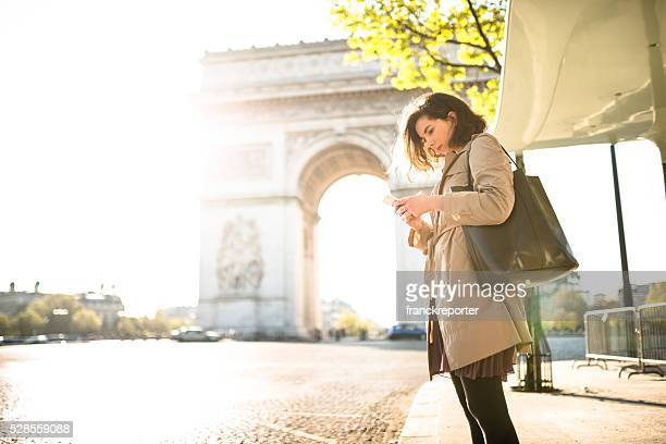 french woman waiting the bus in paris
