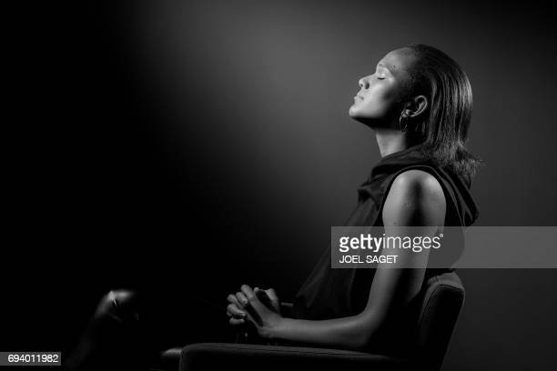 French Women national football team player Wendie Renard poses during a photo session in Paris on June 6 2017 / AFP PHOTO / JOEL SAGET / BLACK AND...