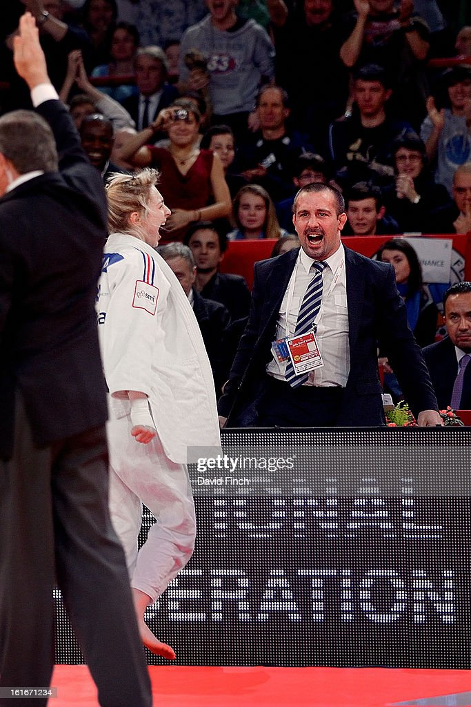French women's coach, Christophe Massina, screams with joy after <a gi-track='captionPersonalityLinkClicked' href=/galleries/search?phrase=Automne+Pavia&family=editorial&specificpeople=7182223 ng-click='$event.stopPropagation()'>Automne Pavia</a> (white) convincingly won the u57kgs gold medal by an ippon in the closing seconds of the final after being behind during the Paris Grand Slam on day 1, Saturday, February 09, 2013 at the Palais Omnisports de Paris, Bercy, Paris, France.