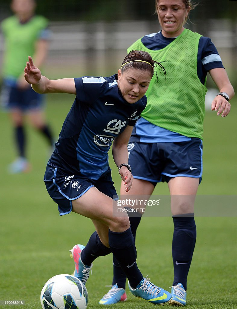 French women's national football team defender Laure Boulleau (L) controls the ball during a training session on June 20, 2013 in Clairefontaine-en-Yvelines, outside Paris, ahead of the July 10 to 28 European Championship in Sweden.