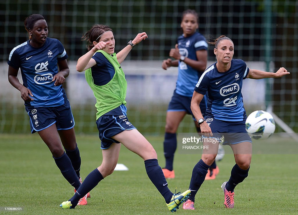 French women's national football team defender Ophelie Meilleroux (R) controls the ball during a training session on June 20, 2013 in Clairefontaine-en-Yvelines, outside Paris, ahead of the July 10 to 28 European Championship in Sweden.