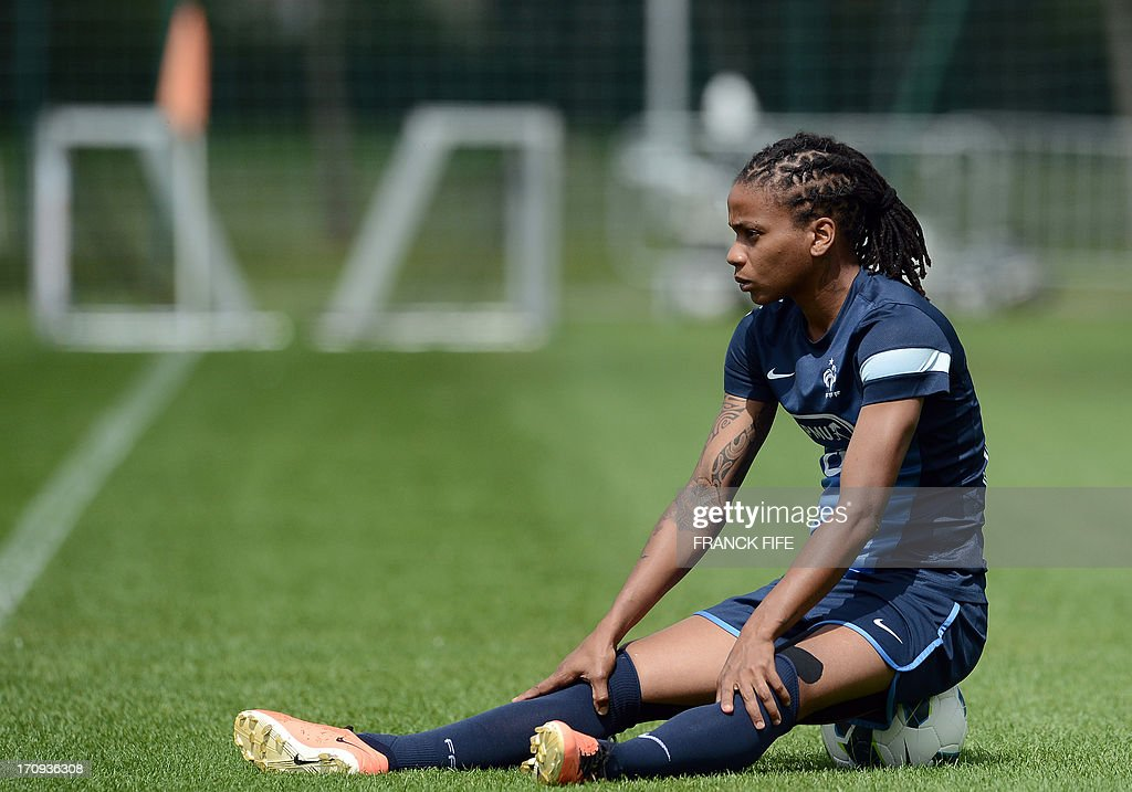 French women's national football team forward Elodie Gomis sits during a training session on June 20, 2013 in Clairefontaine-en-Yvelines, outside Paris, ahead of the July 10 to 28 European Championship in Sweden.