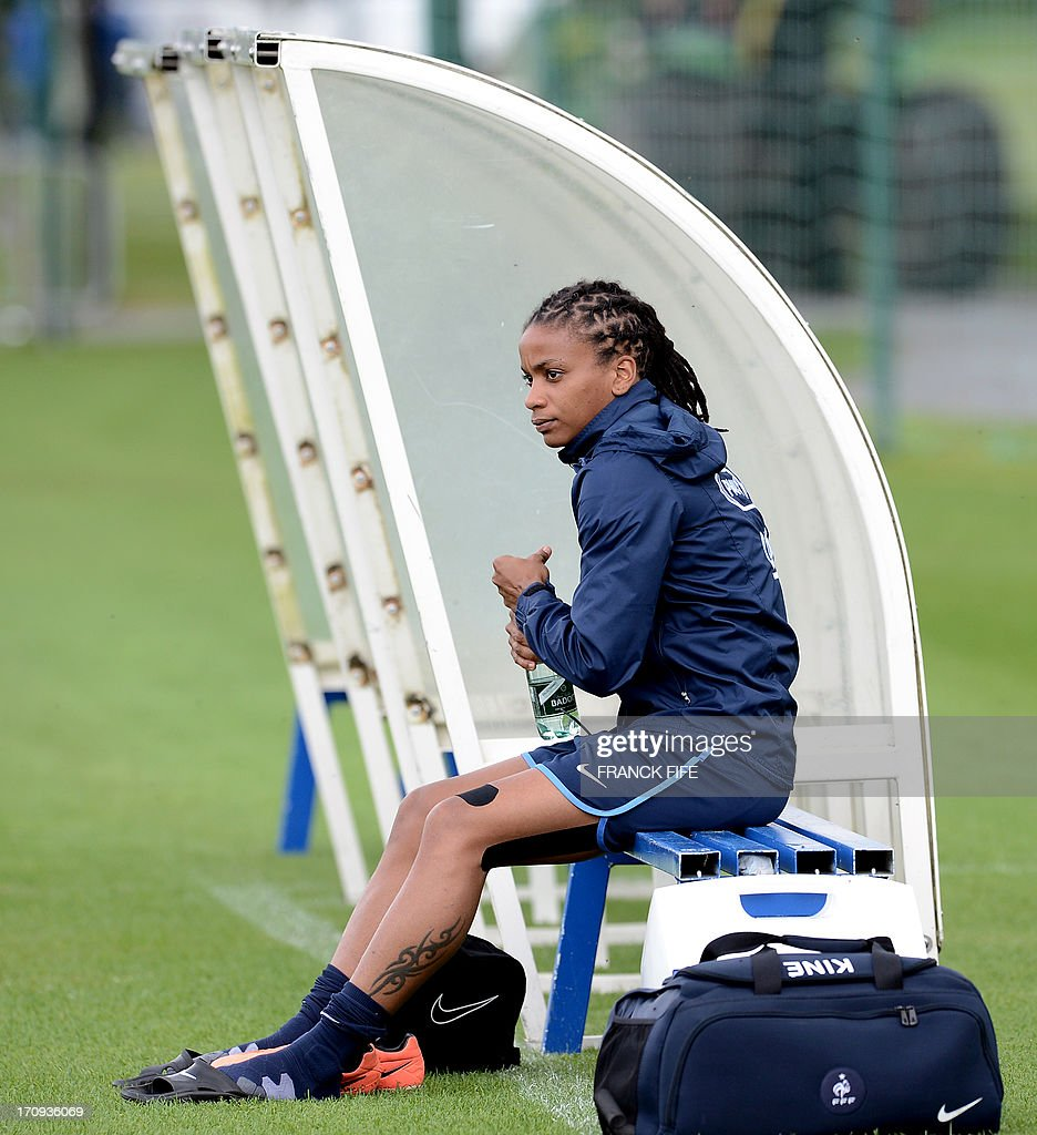French women's national football team forward Elodie Gomis sits on a bench before a training session on June 20, 2013 in Clairefontaine-en-Yvelines, outside Paris, ahead of the July 10 to 28 European Championship in Sweden.