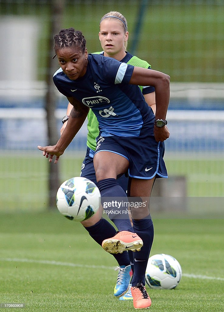 French women's national football team forward Elodie Gomis (front) vies with midfielder Camille Abily during a training session on June 20, 2013 in Clairefontaine-en-Yvelines, outside Paris, ahead of the July 10 to 28 European Championship in Sweden.