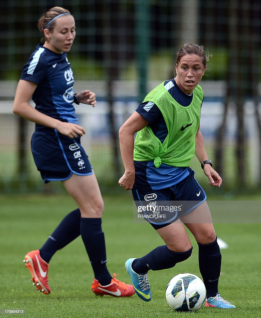 French women's national football team midfielder Camille Abily (R) controls the ball during a training session on June 20, 2013 in Clairefontaine-en-Yvelines, outside Paris, ahead of the July 10 to 28 European Championship in Sweden.