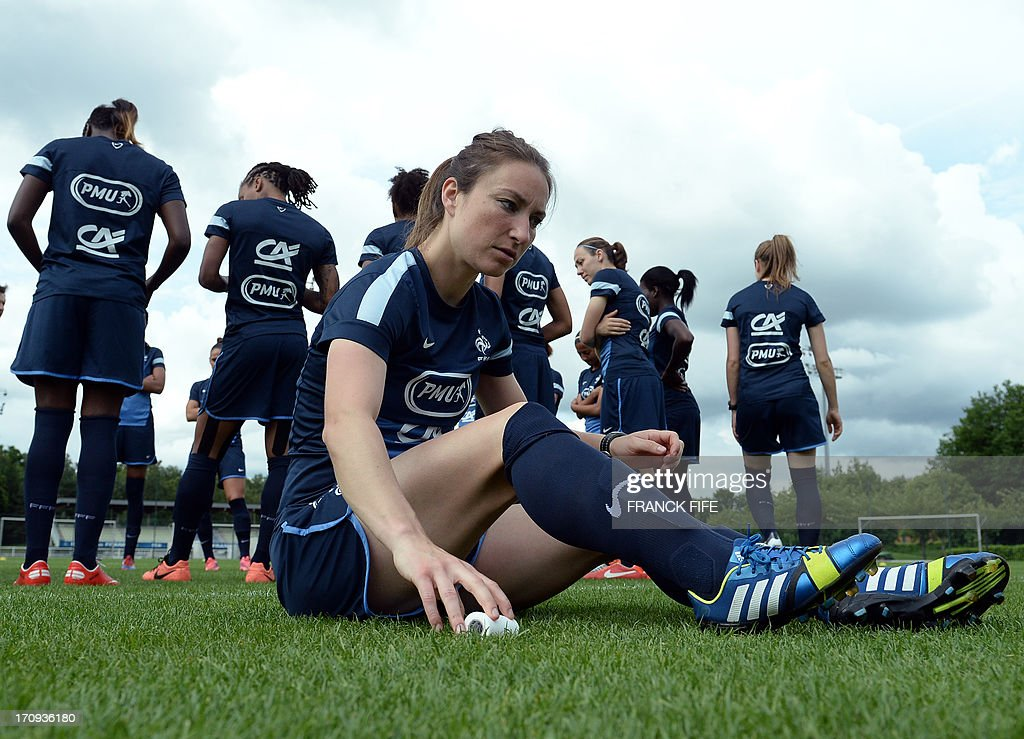 French women's national football team midfielder Gaetane Thiney sits as she gets ready for a training session on June 20, 2013 in Clairefontaine-en-Yvelines, outside Paris, ahead of the July 10 to 28 European Championship in Sweden.