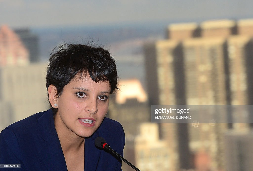 """French Women's Right Minister Najat Vallaud-Belkacem talks to the media at the French UN mission in New York prior to attending a meeting at the United Nations headquarters on December 11, 2012. Vallaud-Belkacem is in New York to attend a meeting on the occasion of Human Rights Day, on the role of """"Leadership in the Fight Against Homophobia."""" AFP PHOTO/Emmanuel DUNAND"""