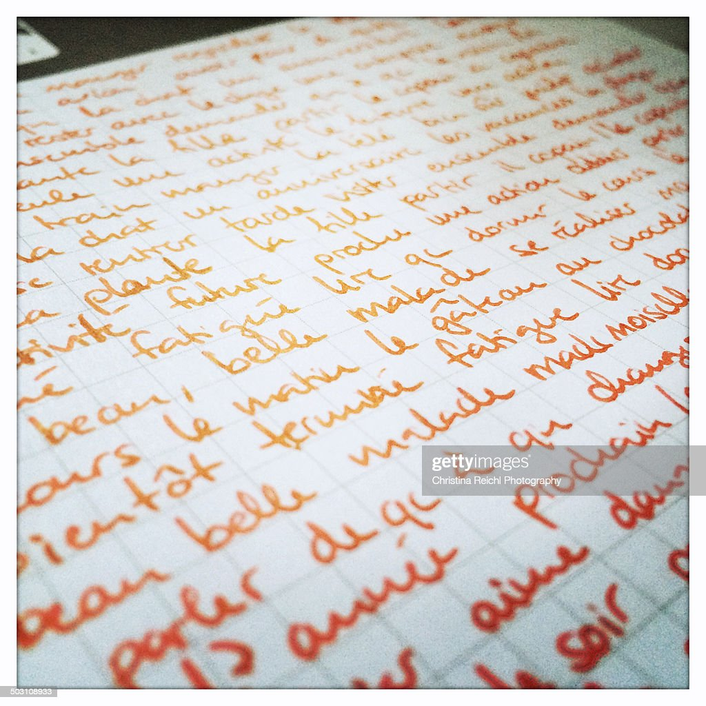 French Words written in red on sheet of paper