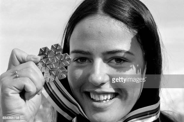 French world champion alpine ski racer Fabienne Serrat poses on February 10 1974 with her golden medal winning at the 1974 World Championships in St...