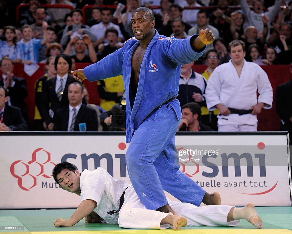 French World champion, Teddy Riner (blue), celebrates defeating Sydney Olympic gold medallist, Kosei Inoue of Japan, with a counter attack in extra time to reach the heavyweight final where he took the gold medal at the Paris Tournament on day 2, Sunday, February 10, 2008 at the Palais Omnisports de Paris Bercy Sports Arena, Bercy, Paris, France.
