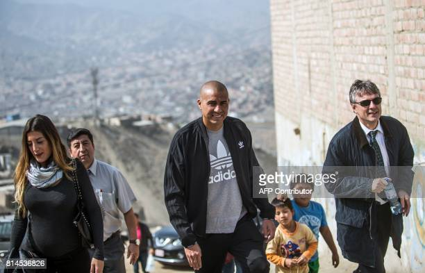 French world football champion David Trezeguet arrives at San Pablo Mirador community Chancay district in the outskirts of Lima to play a football...