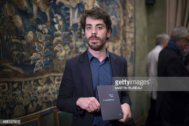 French writer Adrien Bosc poses after winning the French Academy's Grand Prize for his novel 'Constellation' in Paris on October 30 2014 AFP...