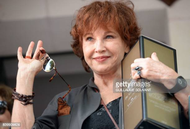 French writer and actress Marlene Jobert waves during the 22th La Foret Des Livres book fair on August 27 2017 in ChanceauxpresLoches central France...