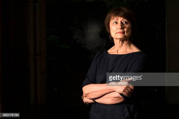 French writer and jury member for the French literary prize Prix Sade Catherine Millet poses in her home in Paris on June 11 2014 AFP PHOTO / JOEL...