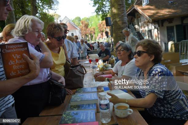 French writer and member of the Goncourt academy Francoise Chandernagor signs books during the 22th La Foret Des Livres book fair on August 27 2017...