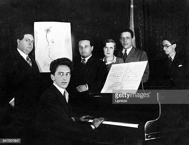 French writer artist and filmmaker Jean Cocteau with five members of the group of French composers known as 'Les Six' 1931 Left to right Darius...