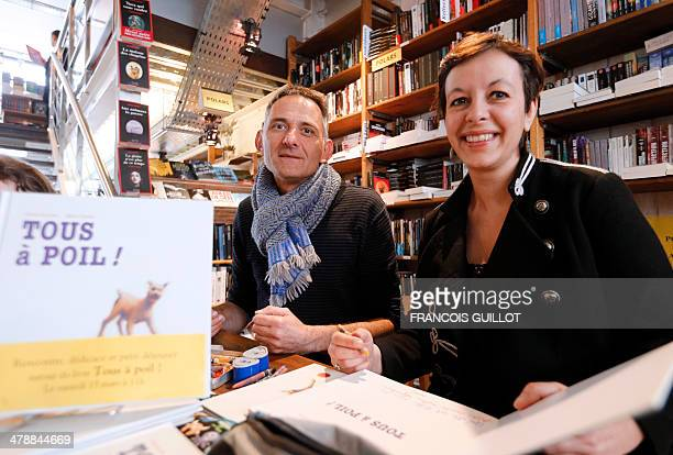 French writer Claire Franek and designer Marc Daniau pose as they sign autographs on March 15 in a Paris bookshop for their children's book 'Tous a...