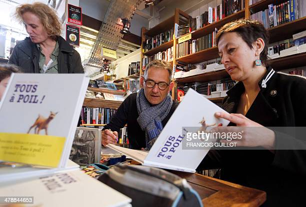 French writer Claire Franek and designer Marc Daniau sign autographs on March 15 in a Paris bookshop for their children's book 'Tous a poil' The book...