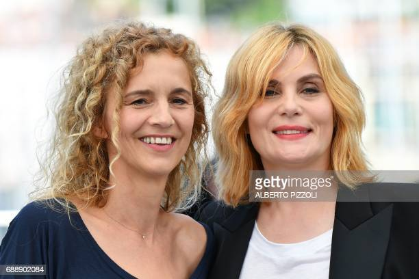 French writer Delphine De Vigan and French actress Emmanuelle Seigner pose on May 27 2017 during a photocall for the film 'Based on a True Story' at...