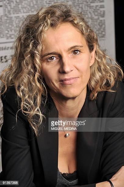 French writer Delphine de Vigan poses during the 'Monde des livres' meeting on October 3 at the Le Monde French daily newspaper hall in Paris This...