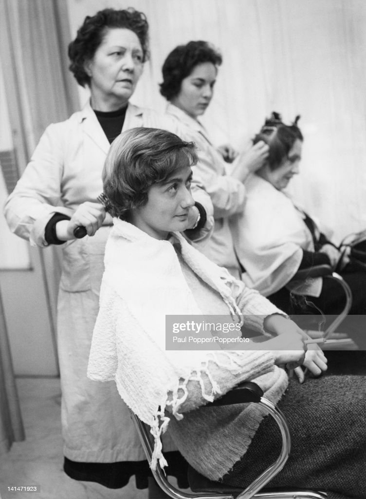 French writer Francoise Sagan visits the salon March 1958
