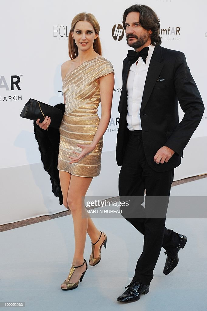 French writer Frederic Beigbeder and French actress Frederic Bel pose while arriving to attend the 2010 amfAR's Cinema Against Aids on May 20, 2010 in Antibes, southeastern France.