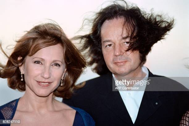 French writer Gonzague Saint Bris president of the Cabourg Romantic Film Festival of Cabourg poses with french actress Nathalie Baye on 13 June 1996...