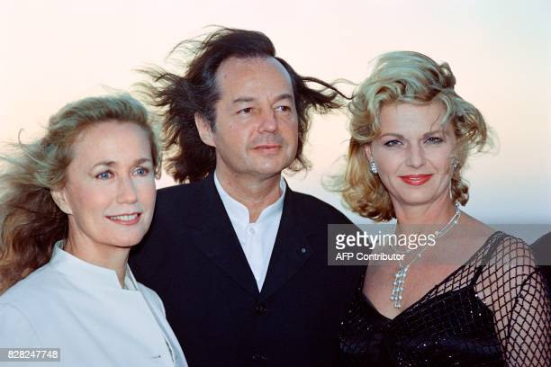 French writer Gonzague Saint Bris president of the Cabourg Romantic Film Festival of Cabourg poses with actresses Brigitte Fossey and Jeane Manson on...