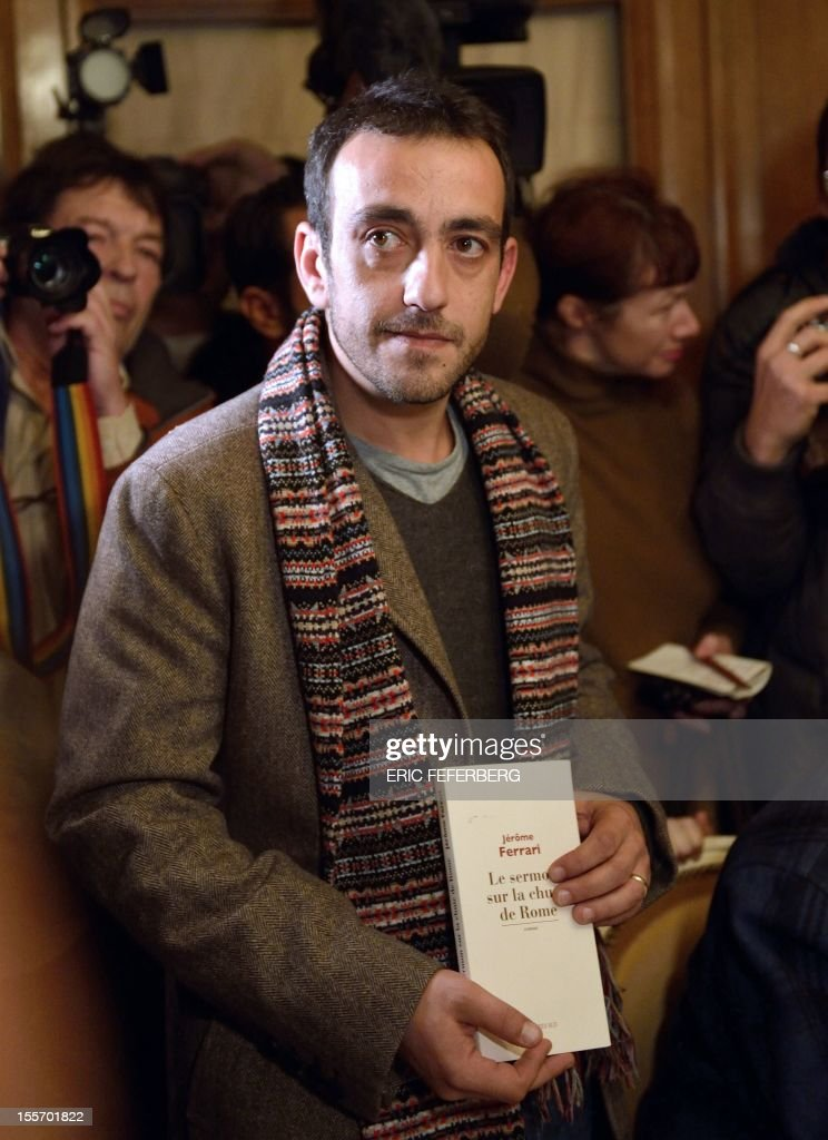 French writer Jerome Ferrari presents his novel 'Le Sermon sur la Chute de Rome' (The Sermon of the Fall of Rome) after he was awarded with France's top literary prize, the Goncourt,on November 7, 2012 at the Drouant restaurant in Paris. Himself a philosophy teacher, currently at the French lycee in Abu Dhabi, the French novelist previously taught in the Corsican capital Ajaccio.