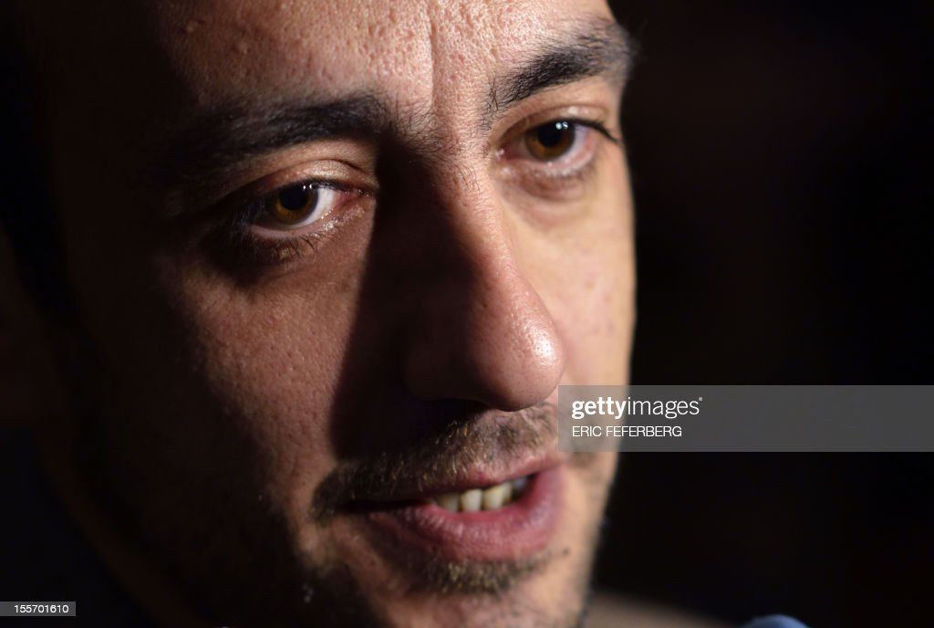 French writer Jerome Ferrari speaks to the press after he was awarded with France's top literary prize, the Goncourt for his novel 'Le Sermon de la Chute de Rome' (The Sermon of the Fall of Rome) on November 7, 2012 at the Drouant restaurant in Paris. Himself a philosophy teacher, currently at the French lycee in Abu Dhabi, the French novelist previously taught in the Corsican capital Ajaccio. AFP PHOTO ERIC FEFERBERG