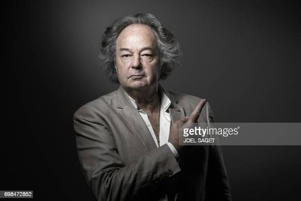 French writer journalist and artist Gonzague Saint Bris adopts the pose of St JeanBaptiste on a painting by Leonardo da Vinci as he poses during a...