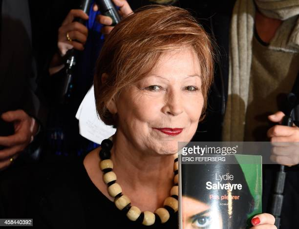 French writer Lydie Salvayre poses after being awarded with France's top literary prize the Goncourt 2014 for her novel 'Pas pleurer' on November 5...