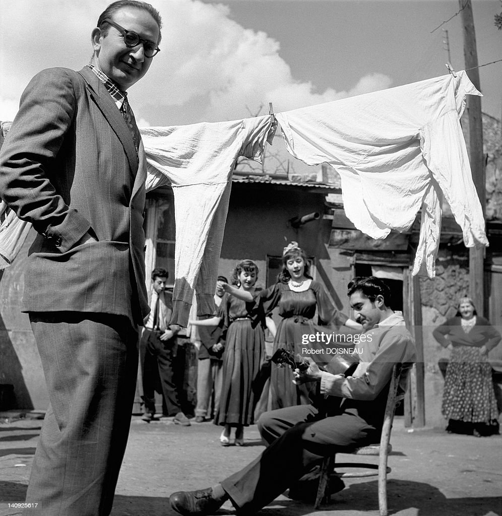 French writer Mateo Maximoff, of Romani ethnicity and an Evangelical pastor poses with gypsies in 1950 in Montreuil, France.