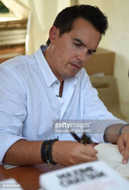French writer Maxime Chattam signs books during the 22th La Foret Des Livres book fair on August 27 2017 in ChanceauxpresLoches central France La...