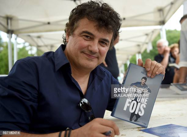 French writer Patrick Pelloux poses during the 21th book fair La Foret Des Livres on August 28 2016 in ChanceauxprèsLoches central France / AFP /...